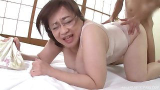 Chubby Japanese amateur mature spreads her legs to ride on the bed