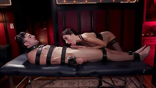 Tied up dude is being dominated by this kinky mistress