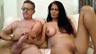 Big breasted latin mom gives handjob
