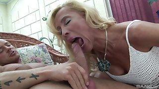 Blonde mature MILF Melissa sucks and rides a big dick