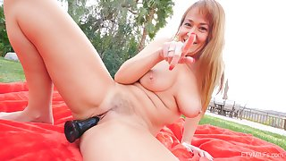Sweet mommy shows off working her new toy in outdoor