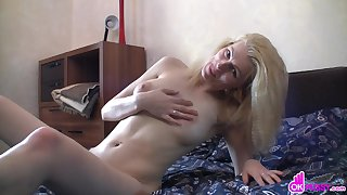 Mature woman first slowly rubs her clit, and then she moves on to a round of passionate