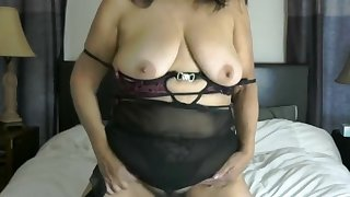 Sexy passionate curvy Latina Woman milf dancing on the bed