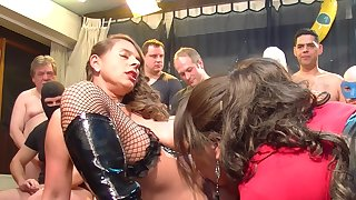 Sexy girls have fun with horny guy group during sizzling orgy party